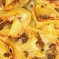 Girelle di lasagne al ragù bianco di carne e funghi