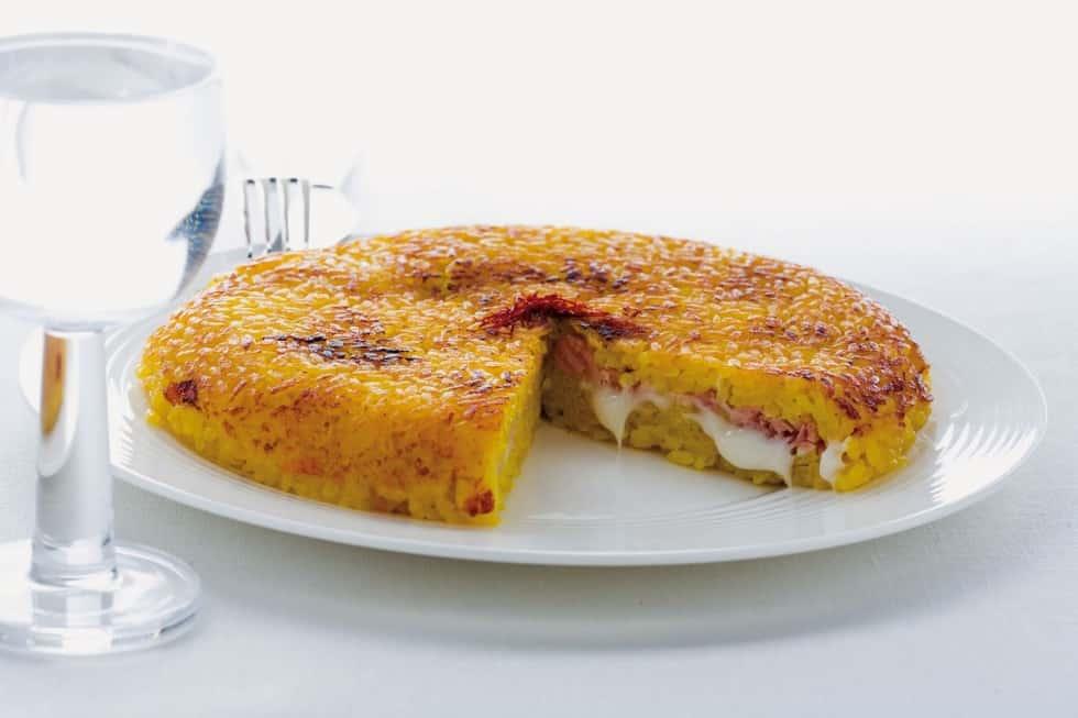 tortino di risotto giallo gratinato alla mozzarella